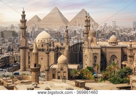 The Mosque Of Sultan Hassan And The Great Pyramids Of Giza, Cairo Skyline, Egypt