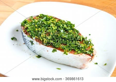 Raw Salmon With Salt, Pepper And Herbs. Red Fish In Marinade
