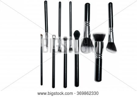 Professional Makeup Brushes Isolated On A White Background.