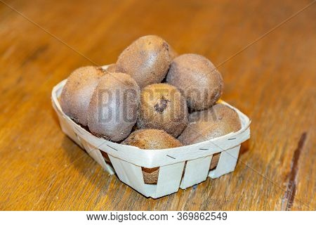 Fruits Of Kiwi In A Wooden Basket