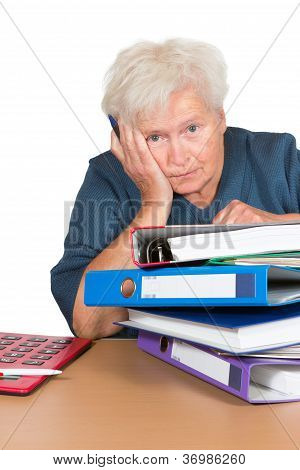Exhausted Senior Lady With Paperwork