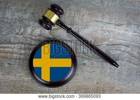 Wooden Judgement Or Auction Mallet With Of Sweden Flag. Conceptual Image.