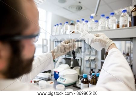 Hands Of Man Researcher Doing Research In A Lab, Researching New Medicament, Chemistry Concept