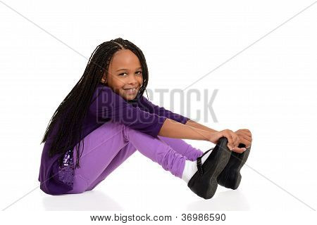 Happy young girl wearing purple sitting