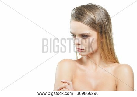 A Girl With An Offended Expression On A White Background.