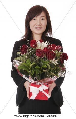 Asian Businesswoman With Red Roses