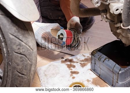 The Process Of Draining Oil From A Motorcycle Engine. Engine Oil Upgrade.