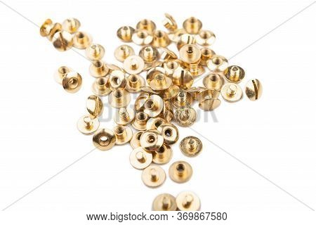 Close-up Of A Brass Screw Rivet, For Electronics, Construction, Engineering, Golden Metal On A White
