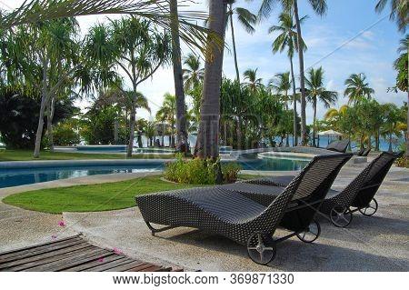 Palawan, Ph - Nov 30 - Swimming Pool And Chairs At Dos Palmas Island Resort On November 30, 2009 In