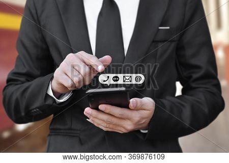Close-up Of Businessman Hand Holding Smartphone With Icon (mobile Phone, And Email Address). Concept
