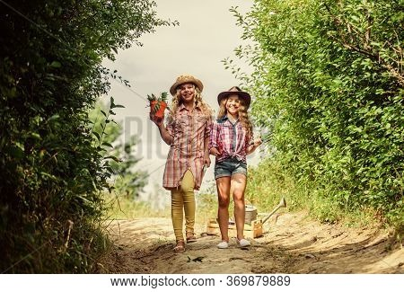 Girls With Gardening Tools. Agriculture Concept. Adorable Girls In Hats Going Planting Plants. Siste