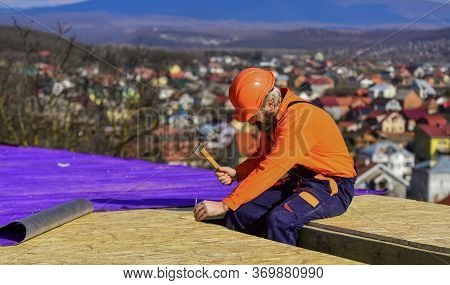 Roofer Constructing New Roof. Builder Roofing Surface. Professional Master Repair Roof. Flat Roof In