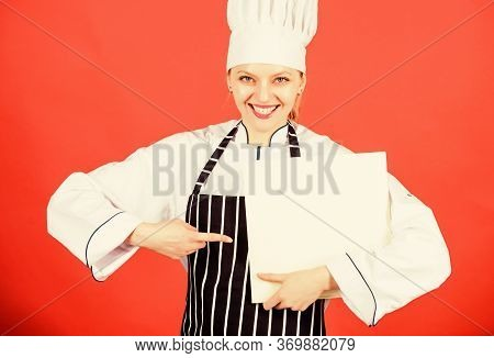 Cook Looking For Cooking Recipe In Cookbook. Woman Reading Cook Book In Kitchen. Tips And Advice. Co