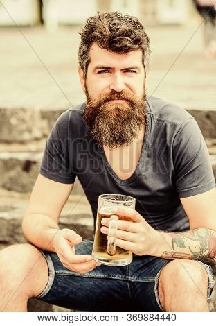 Cafe Summer Terrace. Light Ales Or Dark Stouts Drink Them All. Man With Beard And Mustache Hold Beer