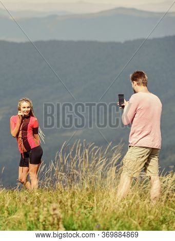 One More Shot. Travel Together With Darling. Couple Taking Photo. Couple In Love Hiking Mountains. L