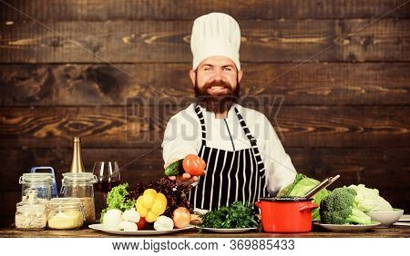 Man Bearded Hipster Hat And Apron Cooking Healthy Food. Vegetarian Lifestyle. Chef Prepare Delicious