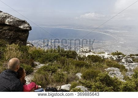 Cape Town - Nov 12, 2015. Man And Woman Gazing Out Upon Cape Town From The A View Point On Top Of Ta