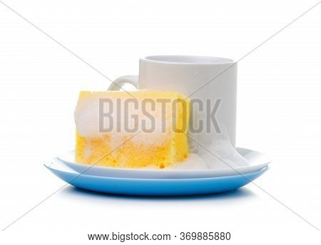 White Plate, Cup With Cleaning Sponge With Soap Foam On White Background Isolation