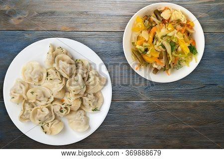 Dumplings On A White Plate On Blue Wooden Background .boiled Dumplings With Salad.meat Dumplings Top