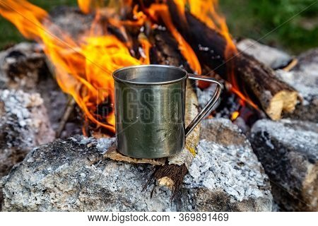 Steel Cup On An Open Fire In Nature. Cooking On Fire. Camping In Summer.