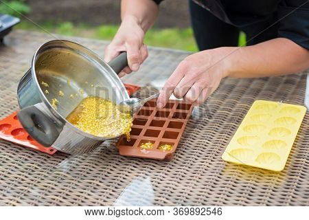 Chef's Hands Pour Hot Citrus Fruit Marmalade Into Silicone Molds. Cooking Marmalade.
