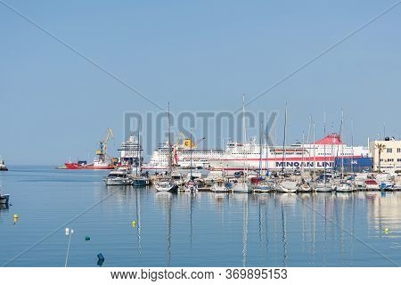 Crete, Greece - May 01, 2019: Yachts And Ferry Boat In The Port Of Heraklion. Panoramic And Top View
