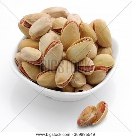 Pistachios, White Background.,roasted Pistachios In A Bowl