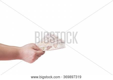 The Picture Shows The Hand Of A Woman Giving Money As Compensation, Have Clipping Path.