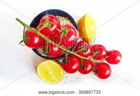 Branch Of Delicious Fresh Cherry Tomatoes, Lemon, Quinoa Over White Background. Quinoa(chenopodium Q