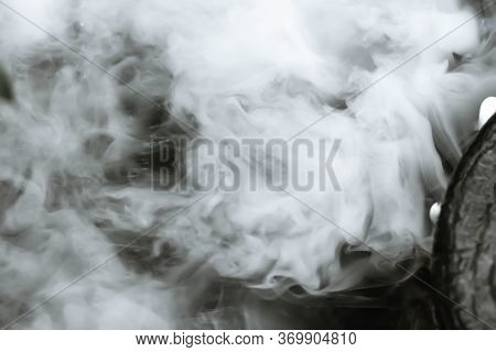 Defocused And Blurred Image For Background. White Steam,hot Springs, Boiling And Steaming Water In G