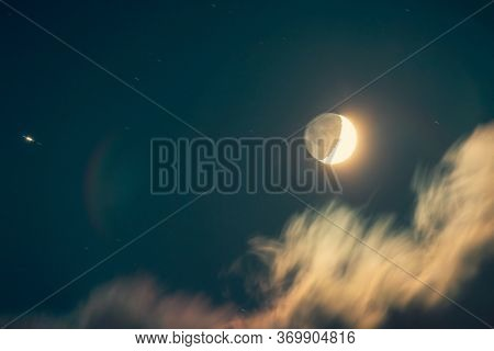 Night of a moon eclipse, dark nighttime sky background with an obscuration, horror holiday, Halloween night