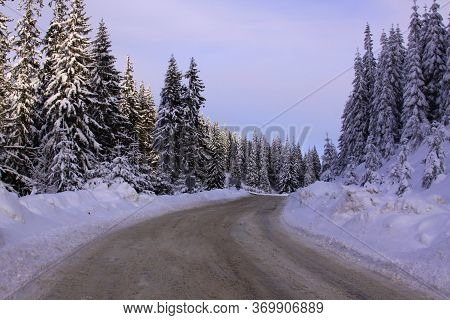 Road To Transalpina Ski Resort In Winter, Covered In Snow, Romania
