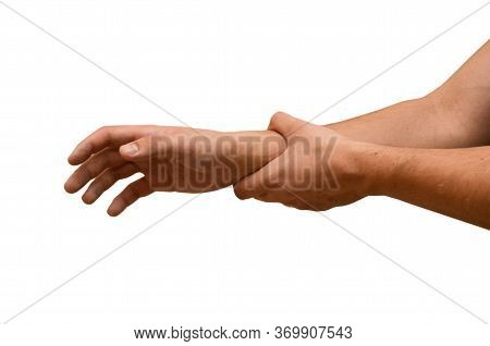 Man Suffers From Wrist Pain, Isolated. Causes Of Pain Include Sprains In The Wrist. Healthcare Conce