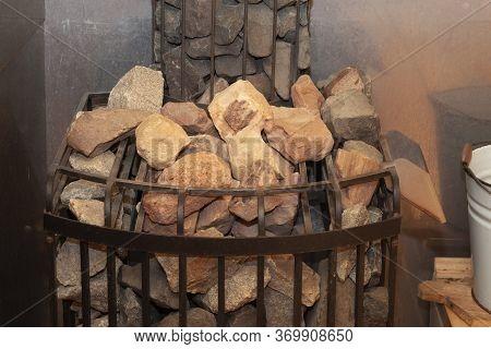 Hot Stones In The Sauna Bath - Finnish Sauna. Stones In The Sauna Heater Close-up. Stones For Heatin