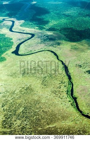 Bird's-eye View Of The River And The Jungle, Taken From An Airplane, South America. The Nature Of Th