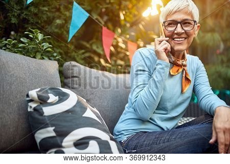 Older woman talking with cell phone outdoor