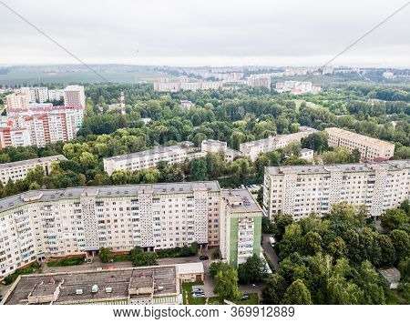 Aerial View Of Town With Socialist Soviet Panel Building At Cloudy Day. Buildings Were Built In The