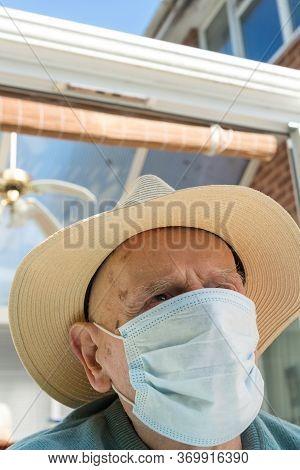 Elderly Man Wearing Face Mask As Coronavirus Protection,hampshire,united Kingdom.
