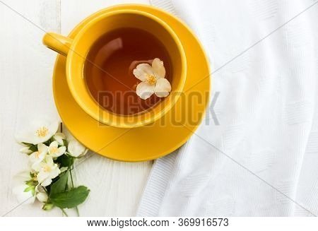 Jasmine Tea. Cup Of Hot Tea With Dry Flowers Top View. Healthy Lifestyle. Cup Of Yellow Herbal Tea O