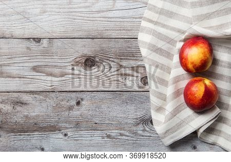 Copy Space With Two Nectarines With Towel On Wood Background. Concept Of Harvest Backdrop For Market