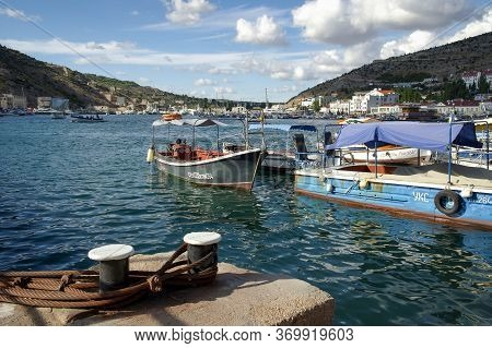 Moored Boats And Pier In A Quiet Balaklava Bay