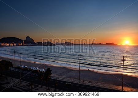Sunrise Over The Atlantic Ocean  And Copacabana Beach, Rio De Janeiro, Brazil