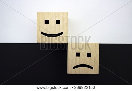 Positive And Negative Emotions. Positive And Negative Thinking. Smiling And Sad Emoticons On Wooden
