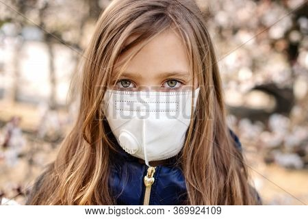 Girl With A Face Protective Mask Is In The City Outdoor