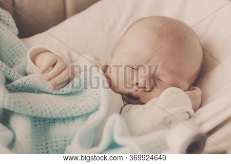 Cute  Newborn Baby Sleeping In The Crib