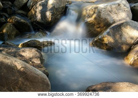 Long Exposure Of Water Running Down A Tributary Of The Putah Creek In Winters, California, Usa, Afte