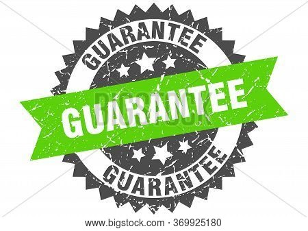Guarantee Grunge Stamp With Green Band. Guarantee