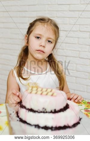 Serious Little Birthday Girl With A Cake