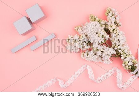 White Lilac With Lace And Calendar On A Pink Background.