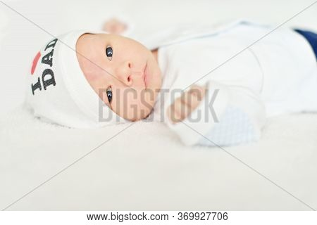 One Week Newborn Baby With Open Eyes